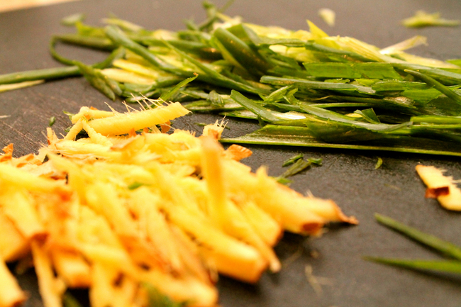 thinly sliced green onion and ginger