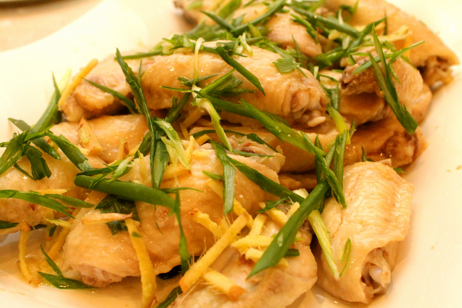 spread ginger and green onion on chicken